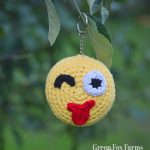 crochet emoji keychain winking with tongue out