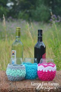 2 wine bottles 3 glasses with crochet wine glass cozy