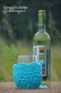 crochet wine glass cozy and bottle of wine