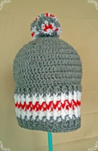 gray crochet hat with red stripe by rebeka harakal
