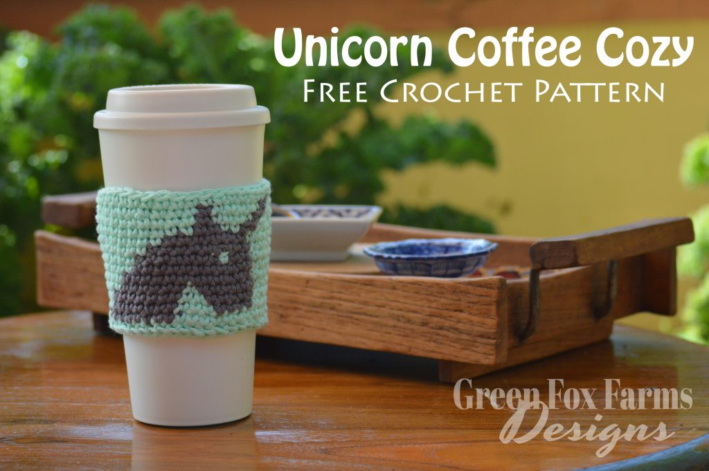 unicorn coffee cozy on cup on table with tray