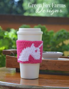 unicorn coffee cozy on table with tray
