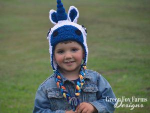toddler boy wearing crochet unicorn hat