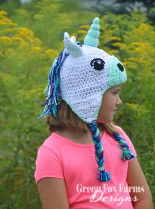 girl wearing crochet unicorn hat