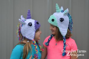 two girls wearing crochet unicorn hat