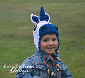 young boy wearing toddler crochet unicorn hat
