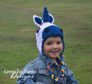 young boy wearing toddler crochet unicorn hat