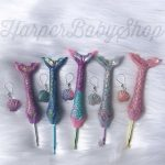 5 mermaid tail shaped crochet hooks in pinks and purples