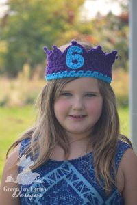 little girl wearing 6 year old birthday crown