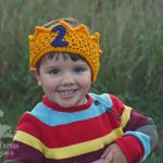 little boy wearing 2 year old birthday crown