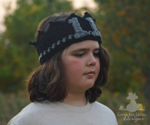 boy wearing 11 year old birthday crown