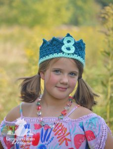 Girl wearing age 8 birthday crown