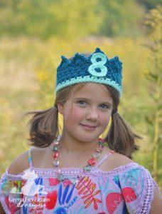 Girl wearing age 8 birthday crown