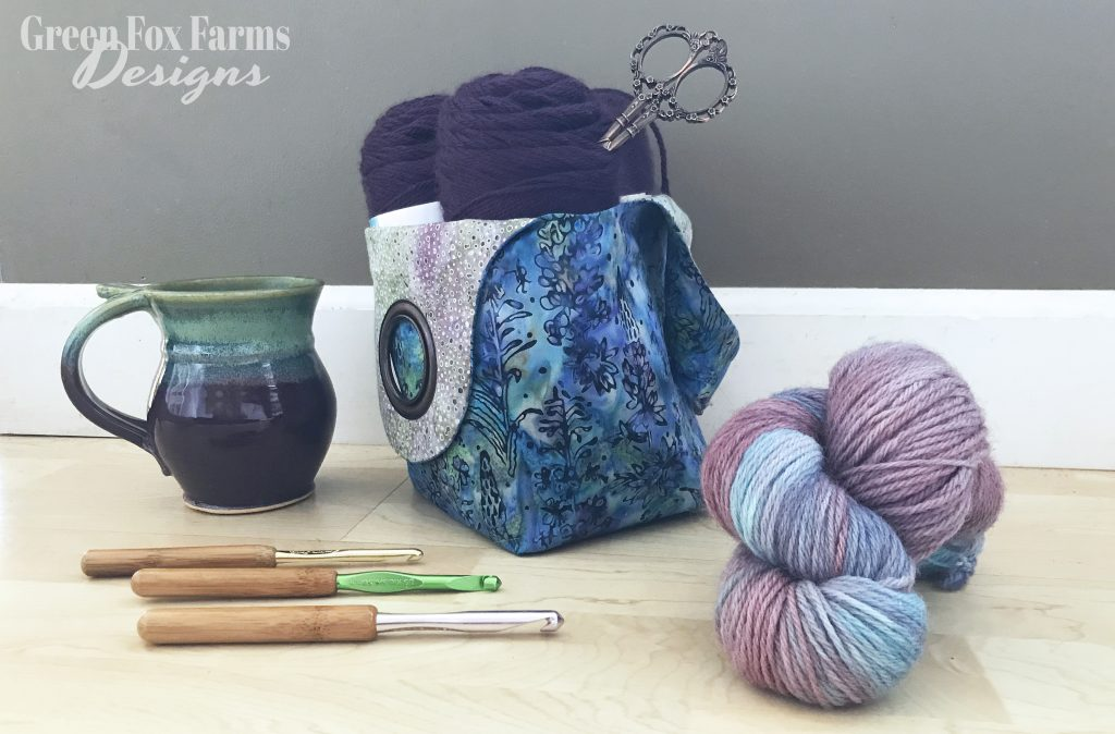 coffee mug crochet hooks bag with yarn and scissors