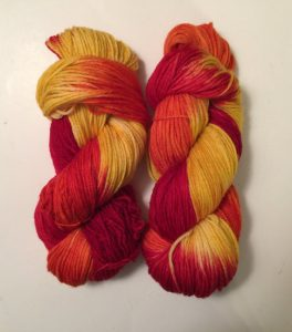 2 hanks of beautifully hand dyed worsted yarn in red, orange and yellows