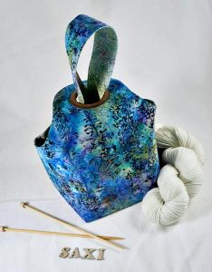 blue batik handsewn project bag with needles and yarn saxi bags