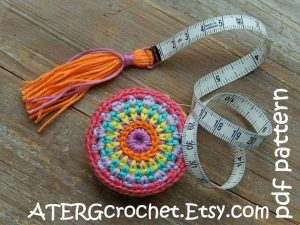 tape measure with tassel and colorful crochet cover