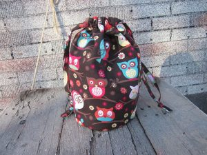 handsewn bag brown fabric with colorful owls