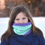 Infinite Spring Scarf is an elegant Crochet Pattern. Crochet your own textured Infinity Scarf or Neck Warmer with this Crochet Pattern. Using your two favorite colors of Red Heart With Love yarn, you can create this beautiful circle scarf! Use this Cowl Pattern to crochet the perfect accessory to take you from chilly autumn days, through winter, and into spring! www.greenfoxfarmsdesigns.com #infinityscarf #fallfashion #springscarf #neckwarmer #crochetpattern #crochetcowl #scarfseason #winterwear
