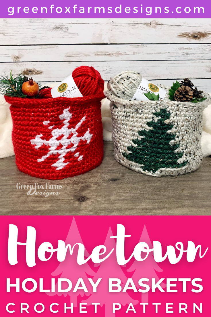 Crochet Hometown Holiday Baskets. Holiday basket crochet pattern using super bulky yarn. Red basket with white snowflake and beige tweed basket with dark green tweed pine tree. Crochet Pattern by greenfoxfarmsdesigns.com